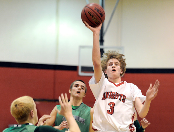 "Fairview High School's Brent Wrapp takes a shot over Elias Tiedgen, left, during a game against Thunder Ridge High School at Fairview in Boulder. For more photos of the game go to  <a href=""http://www.dailycamera.com"">http://www.dailycamera.com</a><br /> Jeremy Papasso/ Camera"