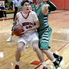 "Fairview High School's Miles MacKenzie drives past Peter Howell during a game against Thunder Ridge High School at Fairview in Boulder. For more photos of the game go to  <a href=""http://www.dailycamera.com"">http://www.dailycamera.com</a><br /> Jeremy Papasso/ Camera"