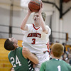 "Fairview High School's Brent Wrapp takes a shot over Zach Rusk, left, and Tanner DeBoer during a game against Thunder Ridge High School at Fairview in Boulder. For more photos of the game go to  <a href=""http://www.dailycamera.com"">http://www.dailycamera.com</a><br /> Jeremy Papasso/ Camera"