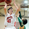 "Fairview High School's Miles MacKenzie takes a shot over Peter Howell during a game against Thunder Ridge High School at Fairview in Boulder. For more photos of the game go to  <a href=""http://www.dailycamera.com"">http://www.dailycamera.com</a><br /> Jeremy Papasso/ Camera"