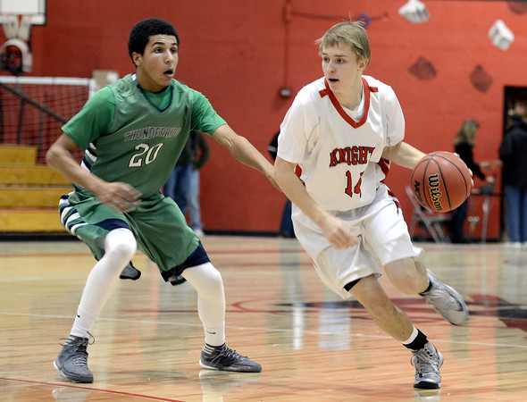 "Fairview High School's Dakota Pilkington drives past Keelan Hammonds during a game against Thunder Ridge High School at Fairview in Boulder. For more photos of the game go to  <a href=""http://www.dailycamera.com"">http://www.dailycamera.com</a><br /> Jeremy Papasso/ Camera"