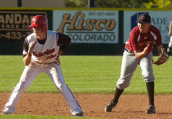 Fairviews Cam Frazier is held at second base by Boulder's Rueben Garcia at Fairview High School on Tuesday June 6, 2011.<br /> Photo by Paul Aiken