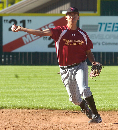 Boulder's Rueben Garcia makes a throw for an out at Fairview High School on Tuesday June 6, 2011.<br /> Photo by Paul Aiken