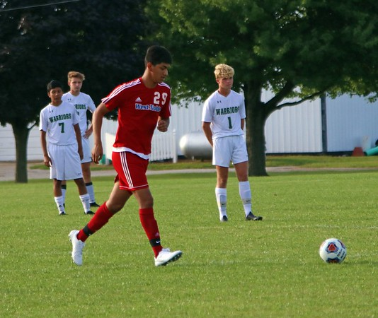 West Noble senior Erik Medina symbollically kicks the ball out of bounds in honor of his teammate, Anthony Reyes, who died in a car accident on Aug. 20. Both West Noble and Wawasee started the game with 10 players on the field Saturday in honor of Reyes.