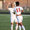 NorthWood senior Sebastian Guillen (11) receives a high-five from teammate Kayden Newcomer after Guillen's first goal in a 3-1 victory over Wawasee Tuesday in Syracuse.
