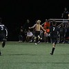 NorthWood senior Andre DeFreitas, shirtless, runs towards the NorthWood fan section following his game-tying goal with 38 seconds left in the game Tuesday against Warsaw in Nappanee.