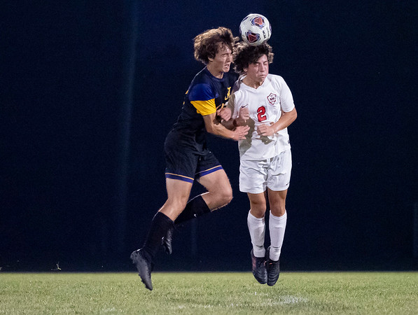 NorthWood Panthers midfielder Joey Eshelman (2) goes up for a header against Angola Hornets midfielder Kane Wagner (13) during Saturdays game at West Noble High School in Ligonier.