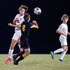 NorthWood Panthers defender Marshall Beebe (13) goes up for a header against Angola Hornets midfielder Kasey Cummings (8) during Saturdays game at West Noble High School in Ligonier.