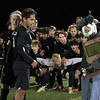 The NorthWood boys soccer team, background, anxiously awaits the regional championship plaque to be presented to its three captains, from left: seniors Andre De Freitas, Kayden Newcomer and Sebastian Guillen.