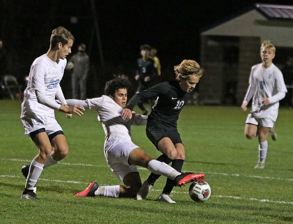 NorthWood senior Andre De Freitas (10) gets taken down in the box by South Bend St. Joseph senior Jose Najar late in the first half of Saturday's regional championship game.