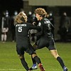 NorthWood sophomore Chase Duerksen (6) celebrates with senior teammate Kayden Newcomer after Duerksen scored the go-ahead goal in the Panthers' 2-1 victory over South Bend St. Joseph in the Class 2A regional championship game Saturday night at Mishwaka Marian High School. It was only Duerksen's second goal of the season.