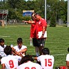 Goshen boys soccer coach Viratham Mounsithiraj talks to his team at halftime in its game against Elkhart Saturday in Elkhart.