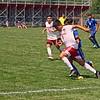 Goshen senior Atruro Hernandez (7) battles for the ball with an Elkhart defender during their game Saturday in Elkhart.