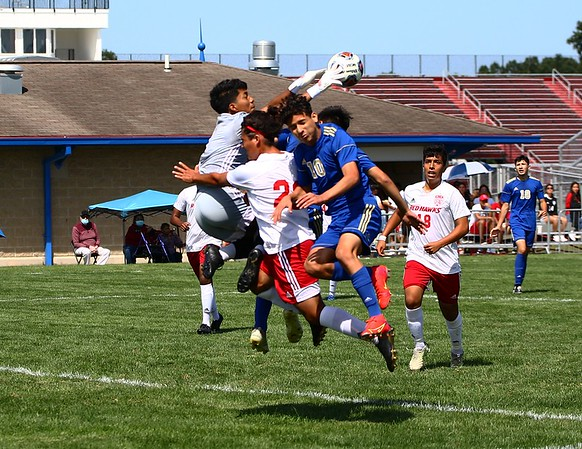 Goshen sophomore goalkeeper Tomas Hernandez, left, soars up to make a save amongst a host of Goshen and Elkhart players in the first half of the game Saturday in Elkhart.