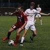 Goshen junior Kovan Drenth (19) and Northridge senior Andrew Janatello (18) battle for the ball during the teams' game Saturday at Goshen High School.