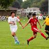 SAM HOUSEHOLDER | THE GOSHEN NEWS<br /> Goshen junior Eduardo Pizana kicks a ball away from Concord freshman defender Christian Saleh during the game Tuesday.