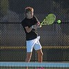Concord sophomore Nathan Schraw plays a shot during the Minutemen's 5-0 victory over DeKalb in the boys tennis regional semifinals Tuesday at Concord High School.
