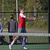 Goshen freshman Pi Wellington returns a shot in the RedHawks' 5-0 loss to Westview in the boys tennis regional semifinals Tuesday at Concord High School.