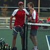 Goshen senior Carlos Lichty, left, and junior Carter Schmucker react after winning their match at No. 1 doubles against Fairfield in the sectional semifinal Wednesday in Goshen. The RedHawks will face NorthWood for the sectional title Thursday evening.