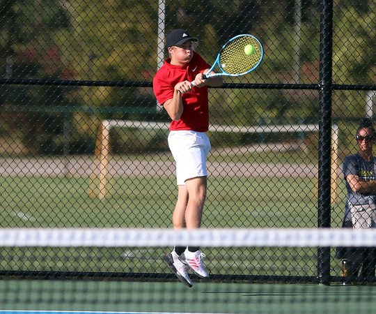 Westview junior Elijah Hostetler hits a backhand shot during the Warriors' 5-0 victory over Goshen in the boys tennis regional semifinals Tuesday at Concord High School.