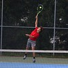 Goshen junior Moses Sawatzky serves the ball during his No. 2 singles match against Bethany Christian Thursday at Bethany Christian High School.