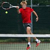 Goshen junior Kaden Priebe hits a forehand shot during is 6-2, 4-6, 6-2 victory at No. 3 singles over Bethany Christian Thursday at Bethany Christian High School in Goshen. The RedHawks beat the host Bruins, 5-0.