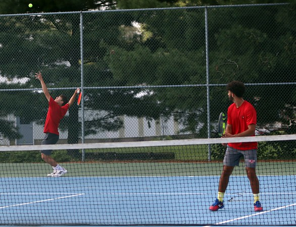 Goshen junior Aidan Ebright Zehr, left, serves the ball while his teammate, senior Soroosh Kermani, looks on during their No. 2 doubles match against Bethany Christian Thursday at Bethany Christian High School.