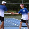 Bethany Christian seniors Austin Shenk, left, and Matthew Dyck high-five each other in between sets of their No. 1 doubles match against Goshen Thursday at Bethany Christian High School.