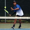 Bethany Christian sophomore Ethan Pairitz goes to hit a forehand shot during his No. 3 singles match against Goshen Thursday at Bethany Christian High School.
