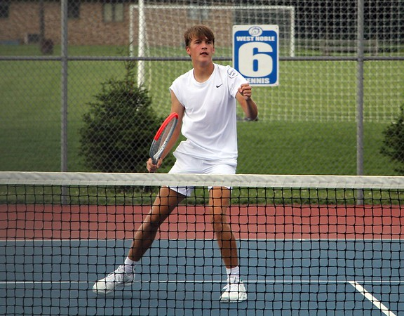 Wawasee No. 1 singles player Holden Babb pumps his fist after winning a point during his match against West Noble Thursday at West Noble High School in Ligonier.