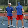West Noble No. 2 doubles player Wes Shaw, left, gives a high five to his teammate JJ Jacobs after scoring a point in their match against Wawasee Thursday at West Noble High School in Ligonier.
