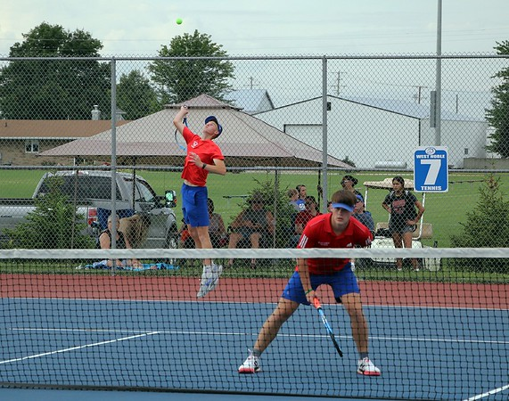 West Noble No. 1 doubles player Nevin Phares, left, serves the ball while his teammate, Brayden Bohde, looks on during their match against Wawasee Thursday at West Noble High School in Ligonier.