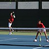 Westview junior Kylen Bender, left, serves the ball while his teammate, junior Jethro Hostetler, looks on during their No. 2 doubles match against Northridge Tuesday at Northridge High School in Middlebury.