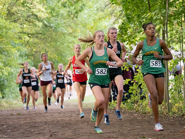 Northridge Raiders Haylee Hile (582) and her teammate Tame Bayliss (583) lead the pack early during Saturday's Varsity Girls NLC Championship at Ox Bow Park in Goshen.