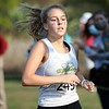Northridge sophomore Haylee Hile runs to the finish line in winning the individual sectional title Saturday at Ox Bow Park in Goshen. Northridge also won the team championship.