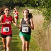 SAM HOUSEHOLDER   THE GOSHEN NEWS<br /> Goshen girls cross country runner Nora Rangel, left and Concord runner Vanessa Steiner run closely during the meet Tuesday at Ox Bow County Park.