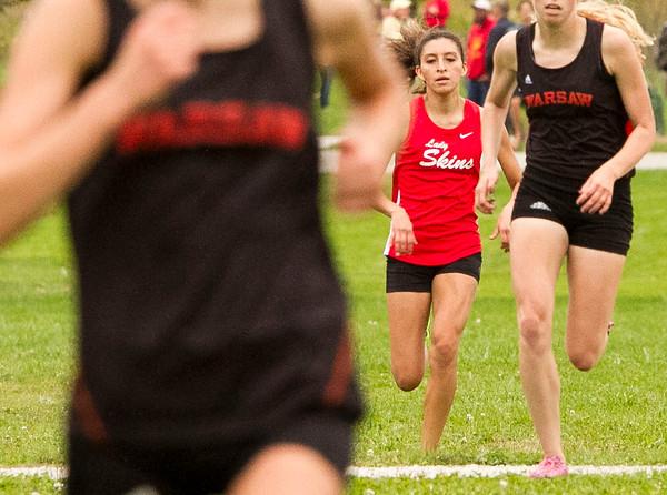 SAM HOUSEHOLDER   THE GOSHEN NEWS<br /> Goshen junior cross country runner Laura Rangel runs to the finish line during the meet against Warsaw and Elkhart Memorial Tuesday at Shanklin Park.