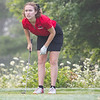 Goshen Redhawks Estella Borden reacts after hitting the ball during the Goshen Girls Golf Invitational Monday morning at Black Squirrel Golf Club in Goshen.
