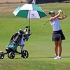 Concord senior Belle Brunner watches an iron shot on the ninth hole of the Warsaw girls golf invitational in this Aug. 22 file photo. Players like Brunner have the Minutemen making their first state finals appearance in program history this weekend.