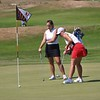 NorthWood senior Abigail Richner, right, makes a putt on the 9th hole while Concord senior Brooke Watson watches on during the Warsaw Invitational Saturday at Stonehenge Golf Club in Winona Lake.