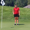 NorthWood senior Bella Sechrist lines up a putt on the fourth hole during the girls golf sectional Saturday at Stonehenge GC in Winona Lake.