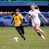 Northridge Raiders senior Taylor Ilnicki-Weaver (3) runs for the ball against Warsaw Tigers forward Audrey Grimm (17) Thursday during the game at Todd Woodworth Field in Middlebury.