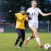 Northridge Raiders senior Taylor Ilnicki-Weaver (3) battles for the ball against Warsaw Tigers forward Audrey Grimm (17) Thursday during the game at Todd Woodworth Field in Middlebury.