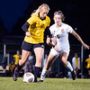 Northridge Raiders freshman Morgan Cross (10) dribbles the ball against Warsaw Tigers midfielder Brielle Fehlmann (5) Thursday during the game at Todd Woodworth Field in Middlebury.