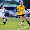 Northridge Raiders senior Hannah Hoffman (2) dribbles the ball against Warsaw Tigers defender Jordan Love (12) Thursday during the game at Todd Woodworth Field in Middlebury.