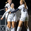 Warsaw Tigers defender Jordan Love (12) celebrates with her teammates midfielder Zoe Bergan (25) and forward Audrey Grimm (17) after scoring a goal Thursday during the game at Todd Woodworth Field in Middlebury.