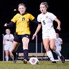 Northridge Raiders senior Anna Vaughn (19) dribbles the ball against Warsaw Tigers midfielder Brielle Fehlmann (5) Thursday during the game at Todd Woodworth Field in Middlebury.