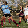 Bethany Christian Bruins midfielder Zoe Williams (11) takes a shot on goal against Central Noble Cougars goalkeeper Meghan Kiebel (00) during Tuesdays game at Elkhart Christian Academy in Elkhart.