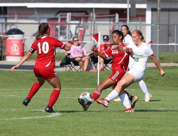 Northridge sophomore Morgan Cross, right, fires a shot past two Goshen defenders Saturday at Goshen High School. The ball would find the back of the net, providing the only goal in a 1-0 win for Northridge.