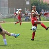 Westview's Brianna Munoz attempts to get in front of a kick by Wawasee's Nicole Beer at Westview High School in Topeka.